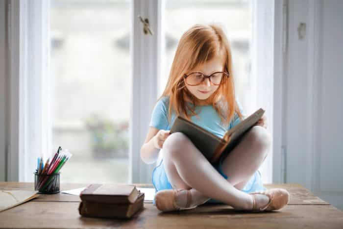 photo of girl reading book